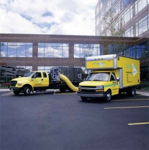 ServiceMaster trucks on site.