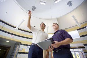 Two technicians discuss a restoration plan.